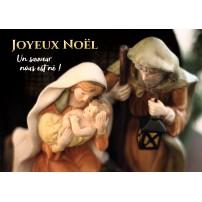 Carte avec Jésus, Marie et Joseph dans une crèche